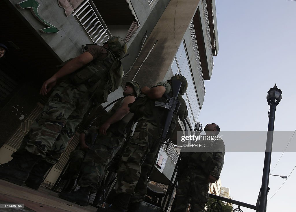Lebanese army soldiers perform search operations in the Abra district of the southern Lebanese city of Sidon on June 24, 2013. At least sixteen soldiers have been killed in clashes with supporters of Sheikh Ahmad al-Assir in southern Lebanon, the army said, in violence tied to rising sectarian tensions fanned by the Syria conflict.