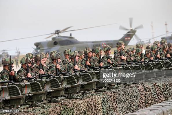 Lebanese Army soldiers stand at attention during a handover ceremony of a shipment of French weapons to the Lebanese Army at Beirut International...