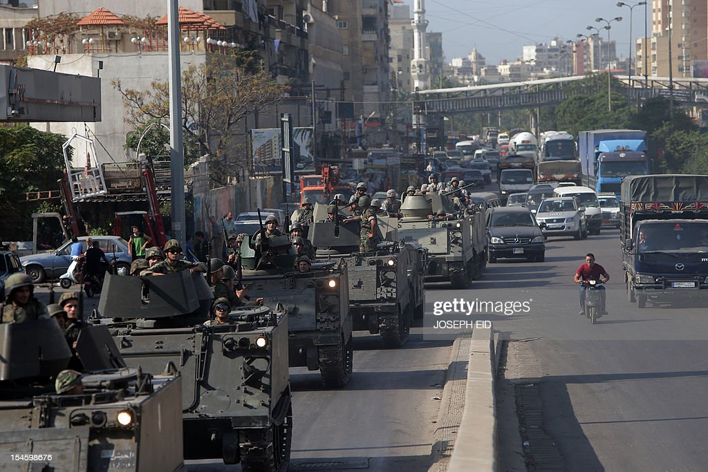 Lebanese army tanks deploy in the Bab al-Tabbaneh and Jabal Mohsen neighborhoods where clashes are taking place between Sunni and Alawites in the coastal city of Tripoli, northern Lebanon, on October 23, 2012. Lebanese troops deployed in Sunni areas of the capital as more sectarian violence erupted, stoking fresh fears after a top security official was killed in a bombing blamed on neighbouring Syria. AFP PHOTO /JOSEPH EID