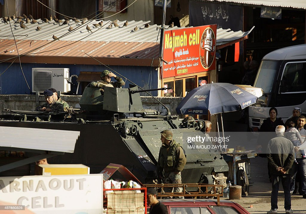 Lebanese army troops are deployed in the southern Lebanese port city of Sidon on December 19, 2013 as the army continues its search for radical Islamists suspected of standing behind a suicide attack against the army in the area last week. The army said earlier this week that a suicide attacker who assaulted a checkpoint in Sidon, the majority Sunni capital of south Lebanon, was Palestinian. An army officer was killed in the December 15 incident, as were two armed men who accompanied the attacker, who were gunned down by troops manning the checkpoint.
