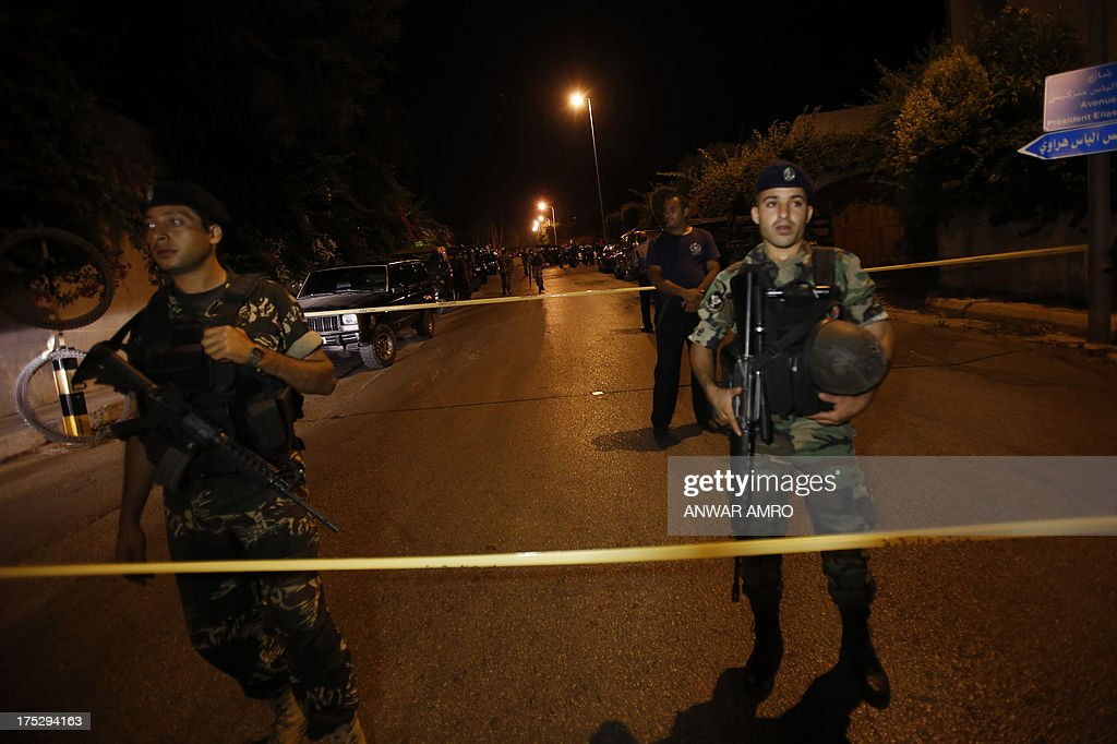 Lebanese army troops block the road leading to a private residence where one of two rockets fired from an unknown location exploded in the early hours of August 2, 2013, just metres from an entrance to the presidential palace in Baabda, around eight kilometres southeast of the Lebanese capital Beirut. The official news agency ANI said the second rocket fell near a Lebanese army training camp in the region of Baabda, causing no casualties as tensions mounted in the east Mediterranean country over the conflict in neighbouring Syria.