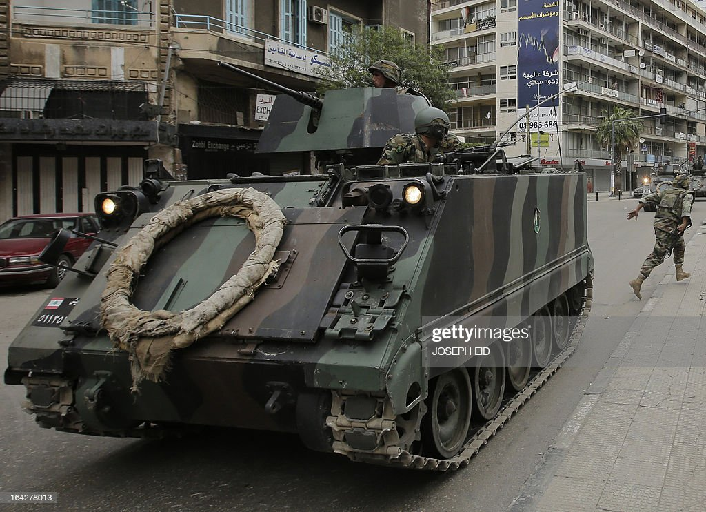 Lebanese army troops patrol the streets of the northern city of Tripoli following clashes between pro- and anti-Syrian regime local gunmen on March 22, 2013. Tripoli has been rocked by deadly clashes between supporters and opponents of Syrian President Bashar al-Assad, where a two-year conflict has killed at least 70,000 people according to UN estimates.