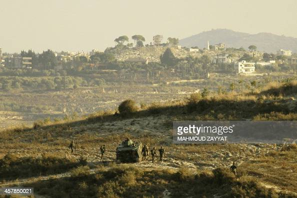 Lebanese army troops search the country side around the southern Lebanese port city of Sidon on December 19 2013 for radical Islamists suspected of...