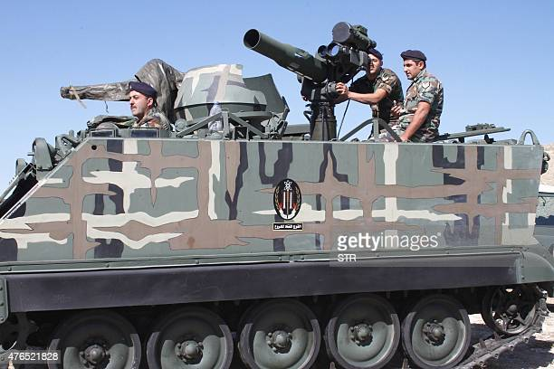 Lebanese army troops take part in a military exercise during the Live Fire Demonstration show at Taybeh military base in the Baalbek region in...