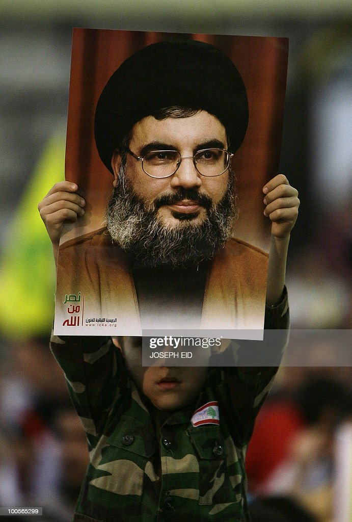 A Lebanese boy in military fatigues holds a picture of Hezbollah leader Hassan Nasrallah during a ceremony marking the 10th anniversary of Israel's withdrawal from southern Lebanon in southern Beirut on May 25, 2010. Nasrallah said that his militants are capable of wiping out Israel's navy and any other ships heading to Israel in the event of a new war with the Jewish state.