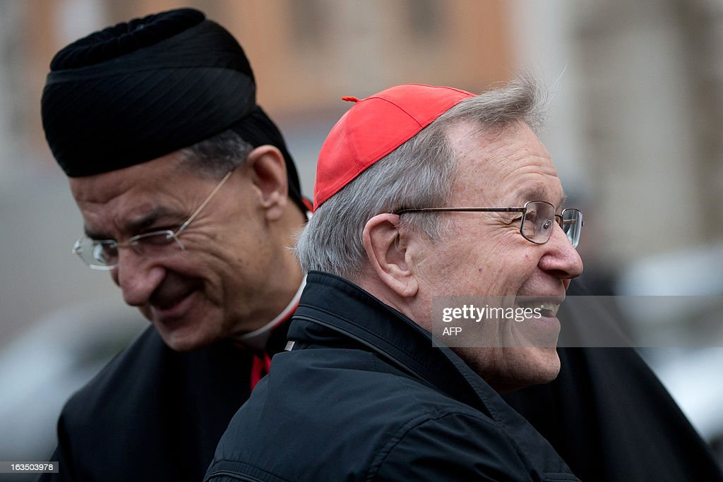 Lebanese cardinal Bechara Boutros al-Rahi (R) chats with German cardinal Walter Kasper upon arrival for a meeting on the eve of the start of a conclave on March 11, 2013 at the Vatican. Cardinals will hold a final set of meetings on Monday before they are locked away to choose a new pope to lead the Roman Catholic Church through troubled times. AFP PHOTO / JOHANNES EISELE