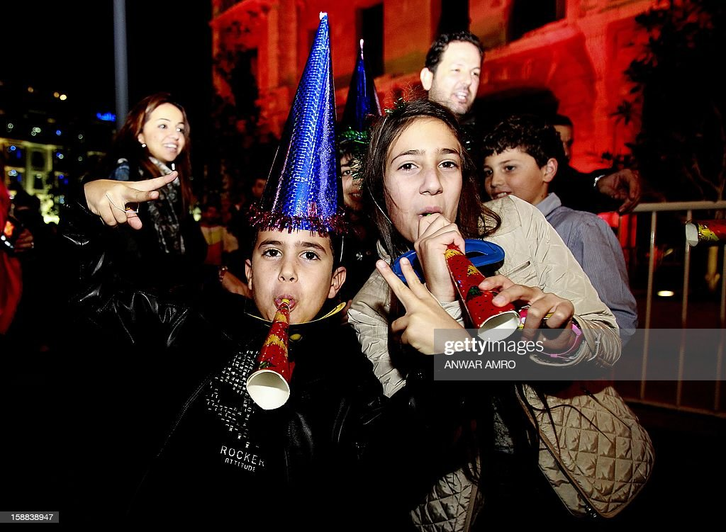 Lebanese children celebrate on new year's eve in Beirut, early on January 1, 2013.