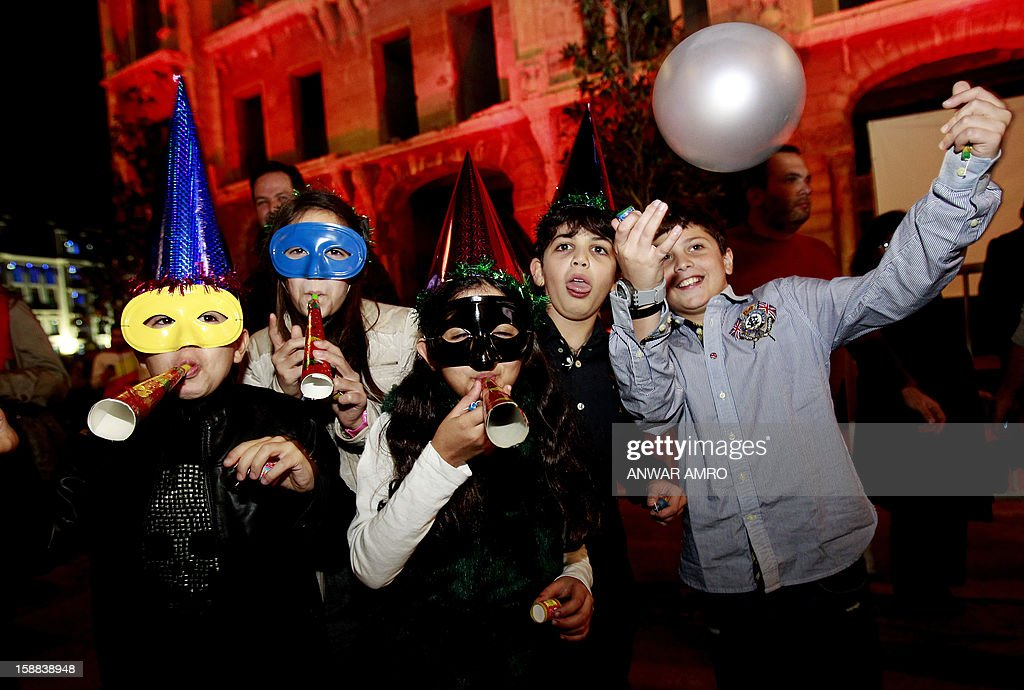 Lebanese children celebrate on new year's eve in Beirut, early on January 1, 2013. AFP PHOTO / ANWAR AMRO