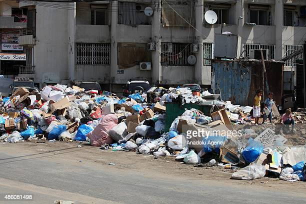 Lebanese children play around a garbage dump in Beirut Lebanon on August 31 2015 After closing one of the main landfill sites and being stopped the...