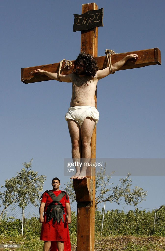 A Lebanese Christian man hangs on a wooden cross during a reenactment of the crucifixion of Jesus Christ during the Good Friday procession in the southern village of Qraiyeh on March 29, 2013. Christians around the world are marking the Holy Week, commemorating the crucifixion of Jesus Christ, leading up to his resurrection on Easter.