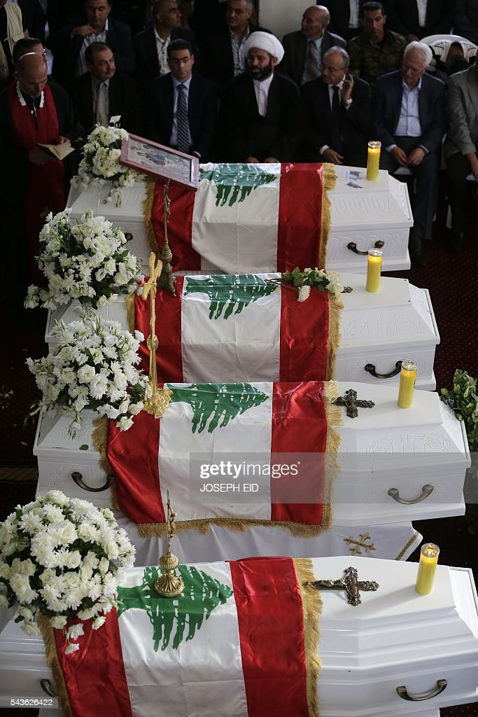 Lebanese Christian mourners attend the funeral service of victims of suicide attacks earlier this week, in the village of al-Qaa, near the country's border with war-ravaged Syria, on June 29, 2016. Two waves of suicide bombings struck the predominantly Christian village on June 27, killing and wounding several people before dawn and in the evening. / AFP / JOSEPH EID