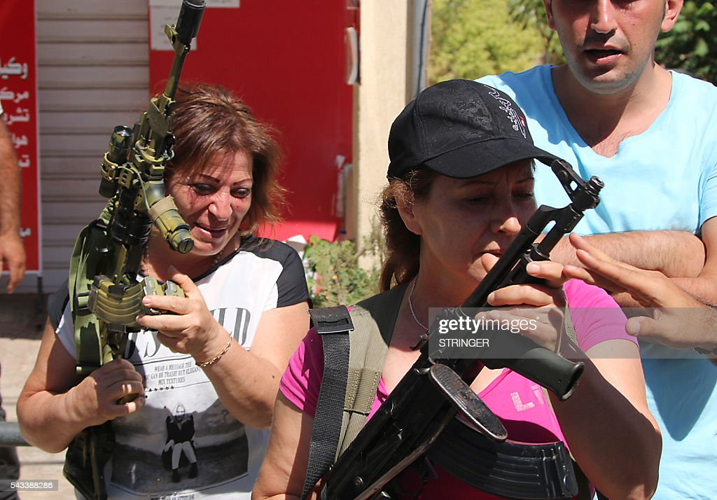 Lebanese Christian women hold weapons as residents of the Christian village of al-Qaa, near the Lebanon's border with war-ravaged Syria, secure the area on June 28, 2016 after two waves of suicide bombings struck the village killing and wounding several people. At least five people were killed and 15 wounded in the pre-dawn attacks in the eastern village of Al-Qaa, in a hilly border area shaken by violence since Syria's conflict erupted in 2011. A security source said two of the attacks were near the municipality building in the centre of the village. / AFP / STRINGER