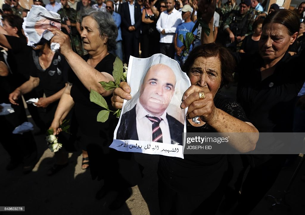 Lebanese Christians mourn the death of relatives, who were killed in suicide attacks earlier this week, during their funeral in the village of al-Qaa, near the country's border with war-ravaged Syria, on June 29, 2016. Two waves of suicide bombings struck the predominantly Christian village on June 27, killing and wounding several people before dawn and in the evening. / AFP / JOSEPH EID