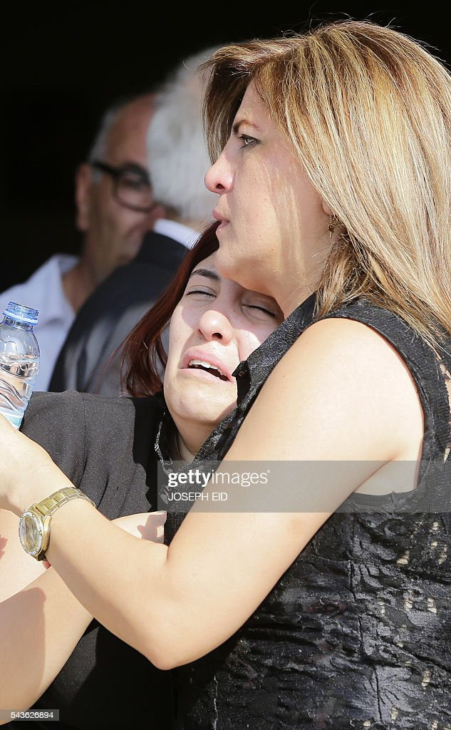 Lebanese Christians mourn the death of relatives who were killed in suicide attacks earlier this week during their funeral in the village of al-Qaa, near the country's border with war-ravaged Syria, on June 29, 2016. Two waves of suicide bombings struck the predominantly Christian village on June 27, killing and wounding several people before dawn and in the evening. / AFP / JOSEPH EID