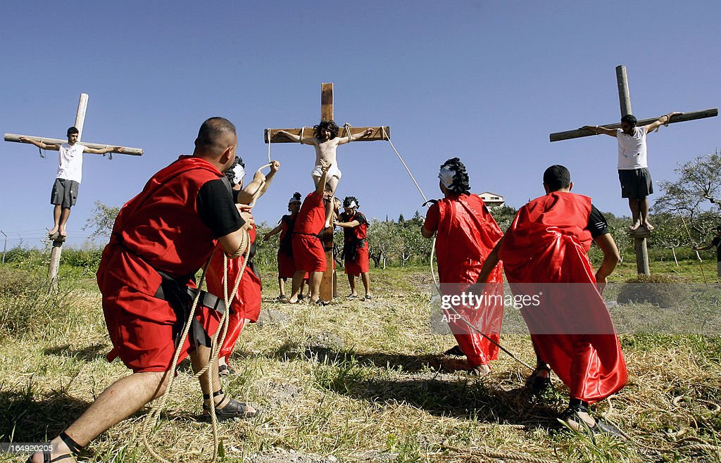 Lebanese Christians reenact the crucifixion of Jesus Christ as they mark Good Friday in the southern village of Qraiyeh on March 29, 2013. Christians around the world are marking the Holy Week, commemorating the crucifixion of Jesus Christ, leading up to his resurrection on Easter.