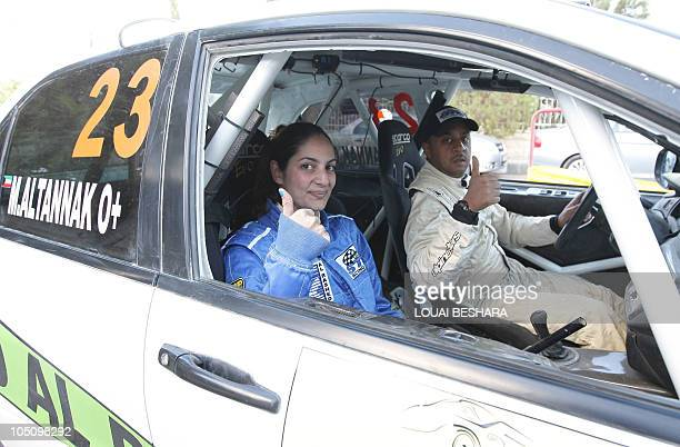 Lebanese codriver Dana Assaf and Kwuaiti team mate Mezher alTnak give the thumbsup at the finish line of the 10th Syrian International Rally round...