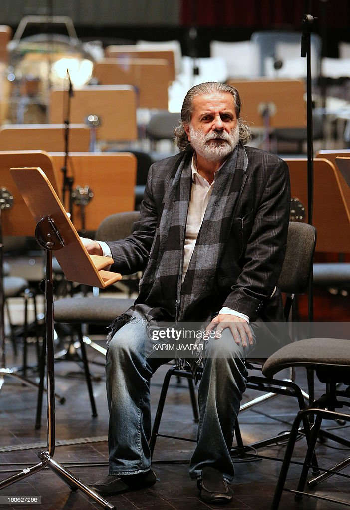 Lebanese composer Marcel Khalife is pictured during a rehearsal with the Qatar Philharmonic Orchestra, presenting choral compositions inspired by the Arab Spring, at the Doha Opera House in the Qatari capital on February 3, 2013.
