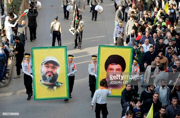 Lebanese demonstrators holding portraits of Hezbollah's secretary general Hassan Nasrallah and the movement's slain former military commander Imad...