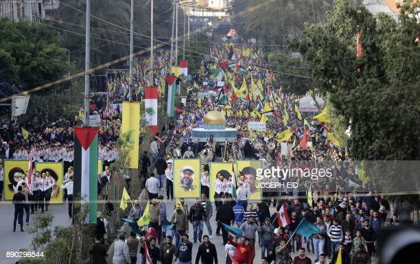 Lebanese demonstrators march with a model of the Dome of the Rock and pictures of former Hezbollah commander Imad Mughniyeh and movement leader...