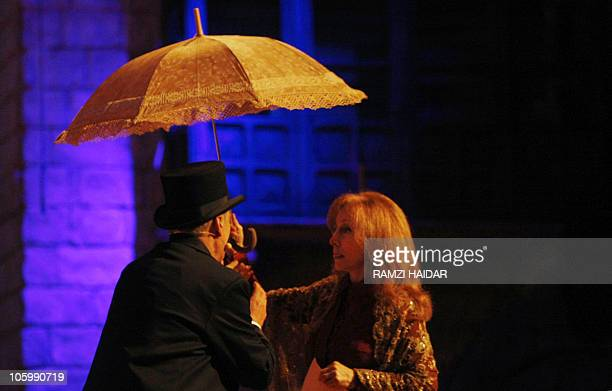 Lebanese diva Fairuz sings with veteran singer Elie Shueiri in 'Sah elNom' in the Gulf emirate of Sharjah on May 2 2008 Fairuz took her popular 1971...