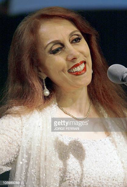Lebanese diva Fairuz smiles to an audience of 2500 people in the Gulf emirate of Dubai 23 January 2003 In a sellout concert the Arab world's most...
