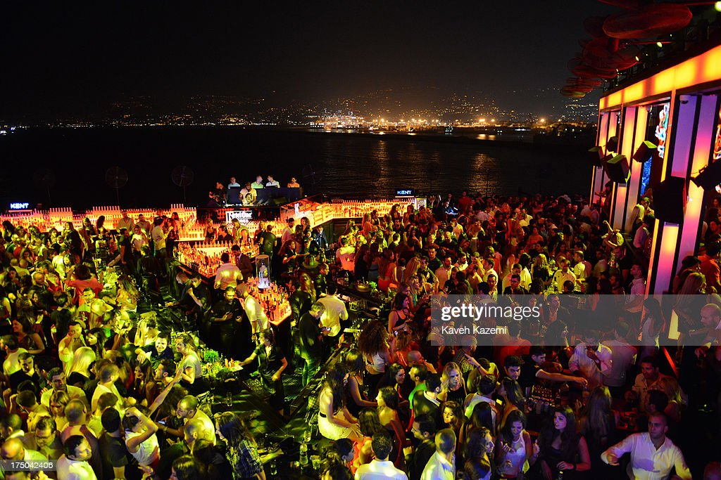 Lebanese drink and dance in Sky Bar night club on July 21, 2013 in Beirut, Lebanon. Sky Bar is a world famous rooftop club, and probably the trendiest exclusive club in the middle east. Despite the rising tensions between different Muslim factions in the country people enjoy their leisure time and continue their daily life as normal.