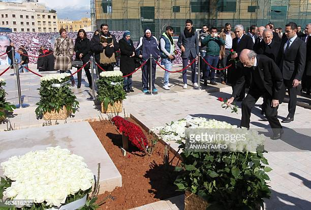 Lebanese Druze leader and Lebanese Progressive Socialist Party chairman Walid Jumblatt places a rose on the burial place of slain former Lebanese...