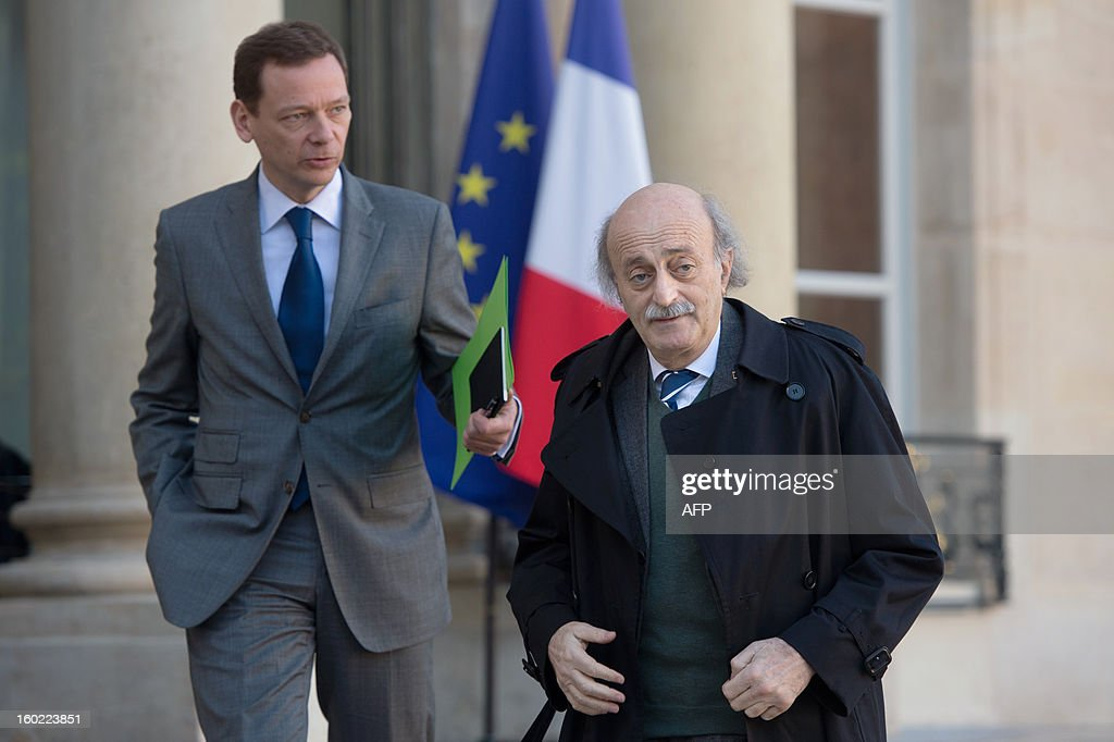 Lebanese Druze leader and Progressive Socialist Party (PSP) chairman Walid Jumblatt (R), flanked by political adviser for North Africa, Middle East and the United Nations Emmanuel Bonne leaves the Elysee presidential palace after a meeting with France's President in Paris on January 28, 2013.