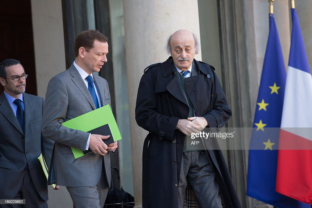 Lebanese Druze leader and Progressive Socialist Party (PSP) chairman Walid Jumblatt (R), flanked by political adviser for North Africa, Middle East and the United Nations Emmanuel Bonne leaves the Elysee presidential palace after a meeting with France's President in Paris on January 28, 2013. AFP PHOTO BERTRAND LANGLOIS