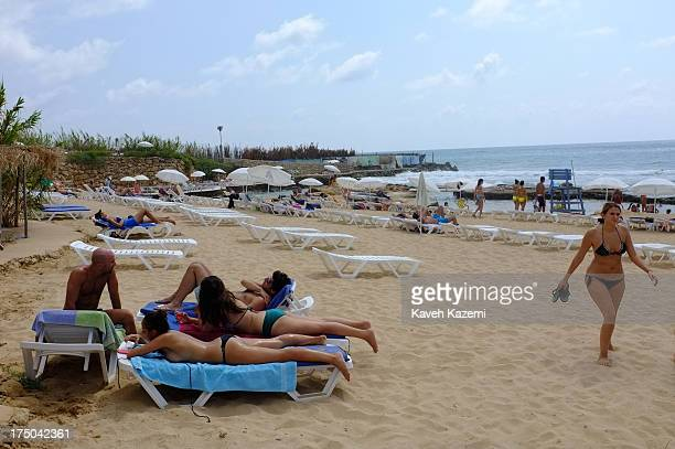 Lebanese enjoy a day at Lazy B beach resort in a secluded surrounding 20 minutes outside the capital on July 21 2013 in Beirut Lebanon Despite the...