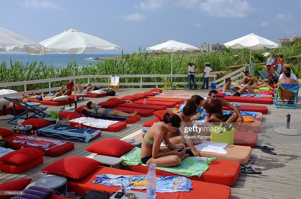 Lebanese enjoy a day at Lazy B beach resort in a secluded surrounding 20 minutes outside the capital on July 21, 2013 in Beirut, Lebanon. Despite the rising tensions between different Muslim factions in the country people enjoy their leisure time and continue their daily life as normal.