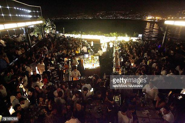 Lebanese enjoy a night out at the open air Sky Bar in Beirut late 18 July 2007 Lebanon's political paralysis and bomb blasts may have deterred summer...