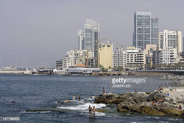Lebanese enjoy the day at a beach along the Mediterranean sea in Ain alMreisseh neighborhood of the capital Beirut on June 27 2012 AFP PHOTO/JOSEPH...