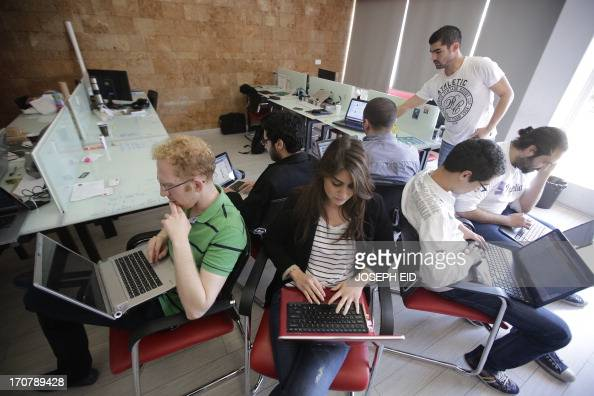 Lebanese entrepreneurs from different internet startup companies work in the offices of 'accelerator' Seeqnce in Beirut's Hamra district on April 24...
