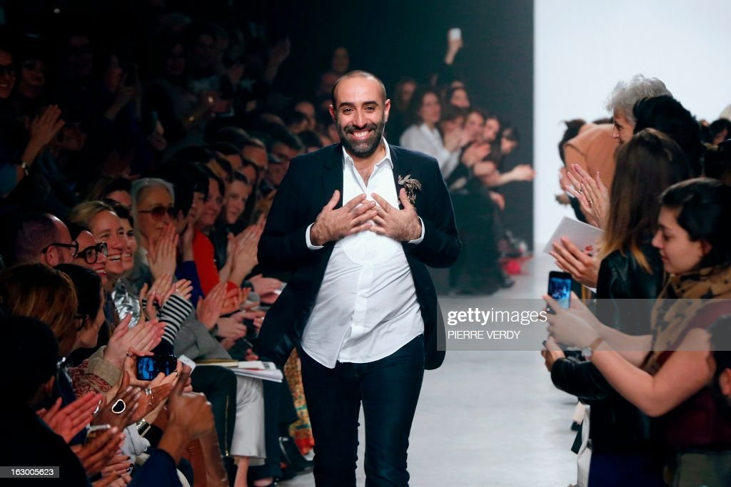 Lebanese fashion designer Rabih Kayrouz for Maison Rabih Kayrouz acknowledges the public at the end of his Fall/Winter 2013-2014 ready-to-wear collection show, on March 3, 2013 in Paris. AFP PHOTO/PIERRE VERDY
