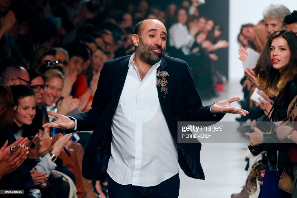 Lebanese fashion designer Rabih Kayrouz for Maison Rabih Kayrouz acknowledges the public at the end of his Fall/Winter 2013-2014 ready-to-wear collection show, on March 3, 2013 in Paris.