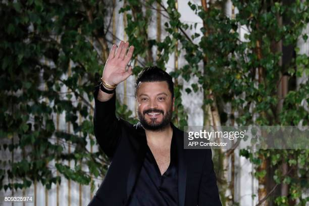 Lebanese fashion designer Zuhair Murad acknowledges the audience at the end of the 20172018 fall/winter Haute Couture collection in Paris on July 5...