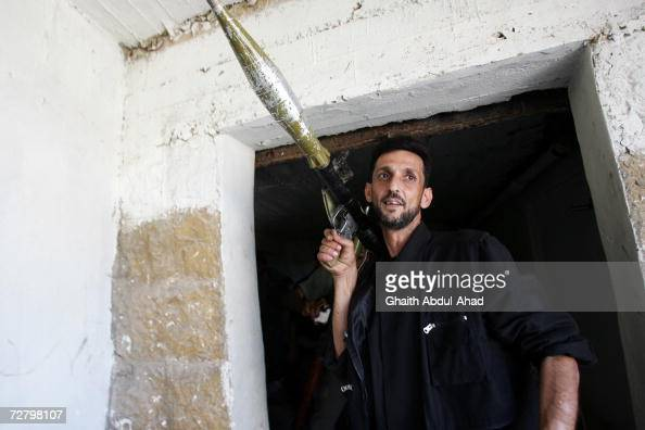 MARJ' EYON LEBANON AUGUST 14 A Lebanese fighter carries his weapons on his shoulder on August 14 2006 in the town of Marj'eyon south of the city of...