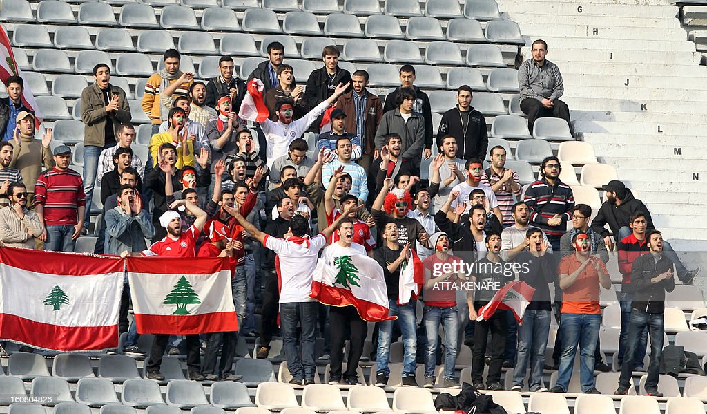 Lebanese football fans cheer for their team during their 2015 AFC Asian Cup group B qualifying football match against Iran at the Azadi Stadium, in Tehran on February 3, 2013. Iran won the match 5-0.