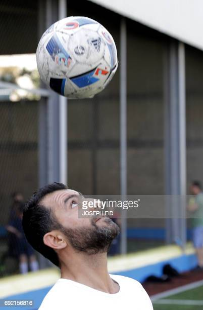 Lebanese Former alNejmeh football team captain Moussa Hjeij heads the ball at a football playground in Beirut on May 12 2017 / AFP PHOTO / JOSEPH EID