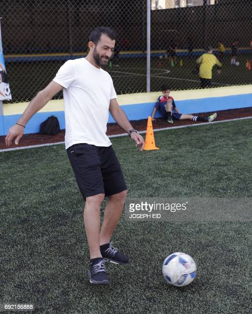 Lebanese Former alNejmeh football team captain Moussa Hjeij juggles the ball at a football playground in Beirut on May 12 2017 / AFP PHOTO / JOSEPH...