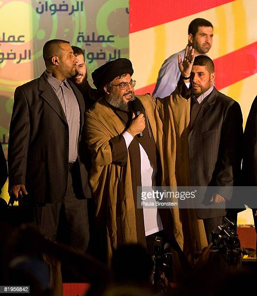 Lebanese Hezbollah chief Hassan Nasrallah waves to the crowd in a rare public appearance July 16 2008 celebrating the release of 5 Lebanese prisoners...