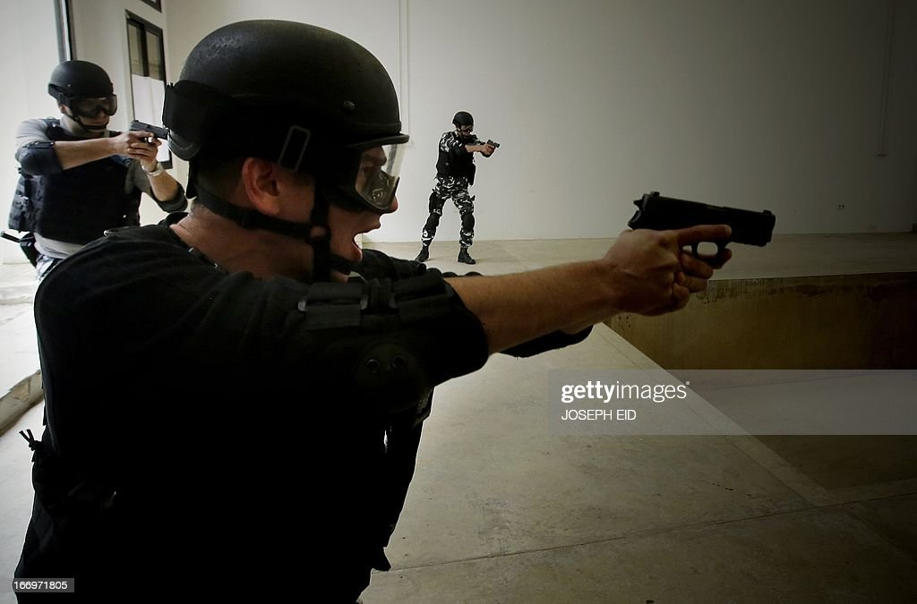 Lebanese Internal Security Forces display their skills on assaulting a drug dealers hideout during a drill of police intervention techniques at the entrance of Beirut International Airport on April 19, 2013. The ISF members were trained under the EU-funded ' Security and Rule of Law' project.