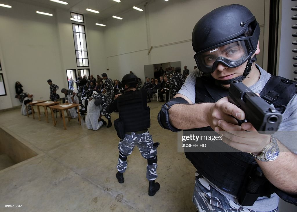 A Lebanese Internal Security Forces member takes an assault position during a drill of police intervention techniques at the entrance of Beirut International Airport on April 19, 2013. The ISF members were trained under the EU-funded ' Security and Rule of Law' project.