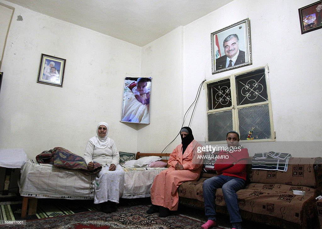 Lebanese Khadija Ayash, 64, (L) a resident Halba shares a single room with five people. A year ago her daughter Umm Ali, who is married to a Syrian, returned with her family from Syria to Lebanon, fleeing violence there. Syrian refugees in Lebanon are demanding the creation of a camp like in Turkey and Jordan, but the Lebanese government and the United Nations reject the idea. AFP PHOTO / ANWAR AMRO