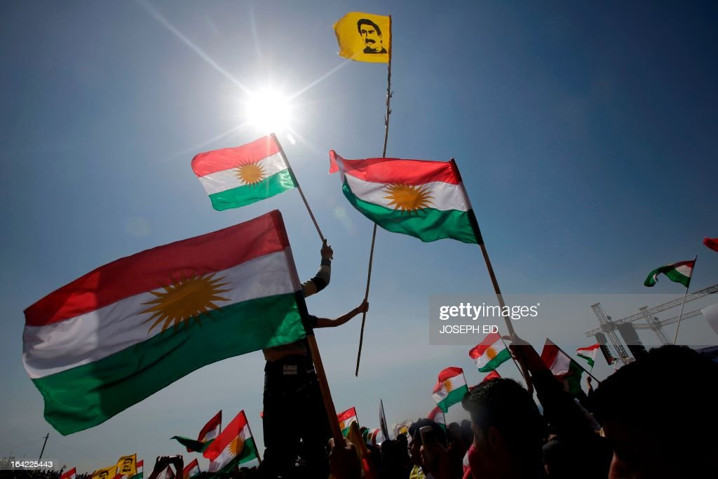 Lebanese Kurds wave the Kurdish flag and flag picturing Kurdish rebel chief Abdullah Ocalan as they celebrate Noruz in the capital, Beirut, on March 21, 2013. The Persian New Year is an ancient Zoroastrian tradition celebrated by Iranians and Kurds which coincides with the vernal (spring) equinox and is calculated by the solar calender. AFP PHOTO/JOSEPH EID