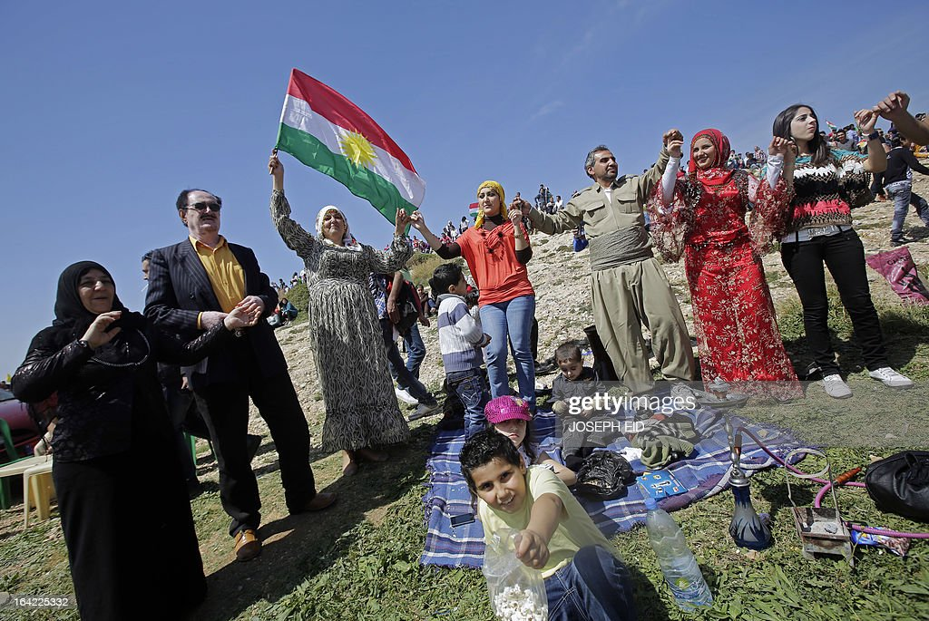 Lebanese Kurds waving the Kurdish flag celebrate Noruz in the capital, Beirut, on March 21, 2013. The Persian New Year is an ancient Zoroastrian tradition celebrated by Iranians and Kurds which coincides with the vernal (spring) equinox and is calculated by the solar calender. AFP PHOTO/JOSEPH EID