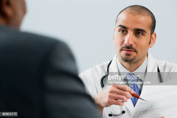 Lebanese male doctor talking with patient