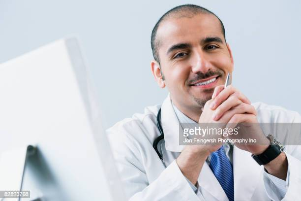 Lebanese male doctor with computer
