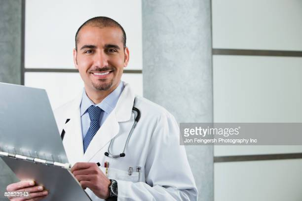 Lebanese male doctor with medical chart